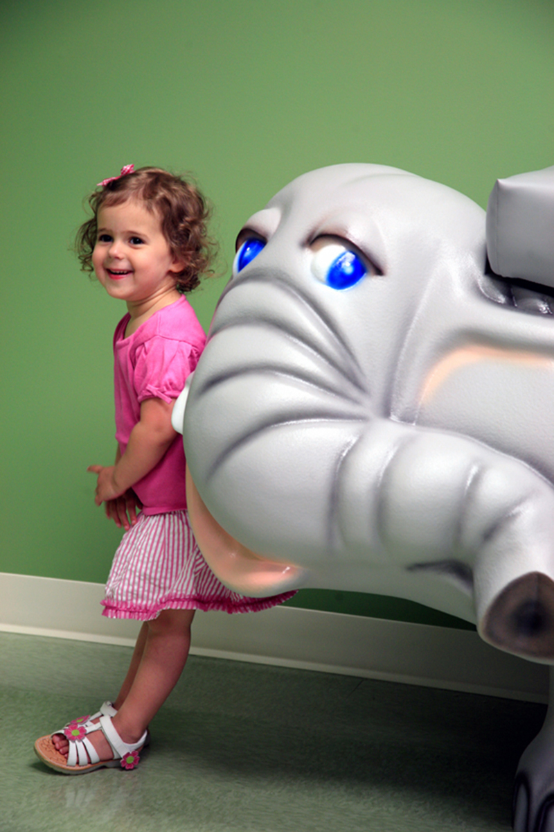 "Young girl visits Hirsch Pediatrics and has a happy appointment in the ""Zoo"" room in Rockville, Maryland"